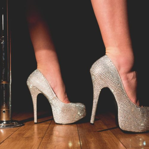 Close up of dancer's shoes as she poses on stage
